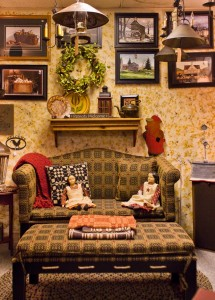 Custom roped camelback sofa and ottoman by Johnston Benchworks. Textiles, dolls, framed prints and accessories overflow the shop.